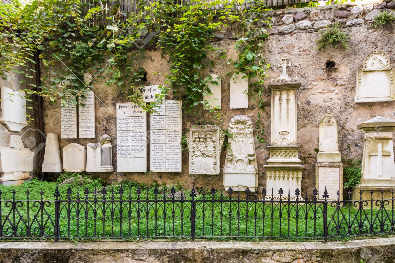 ancient burial tombstones affixed to the walls at the cathedral
