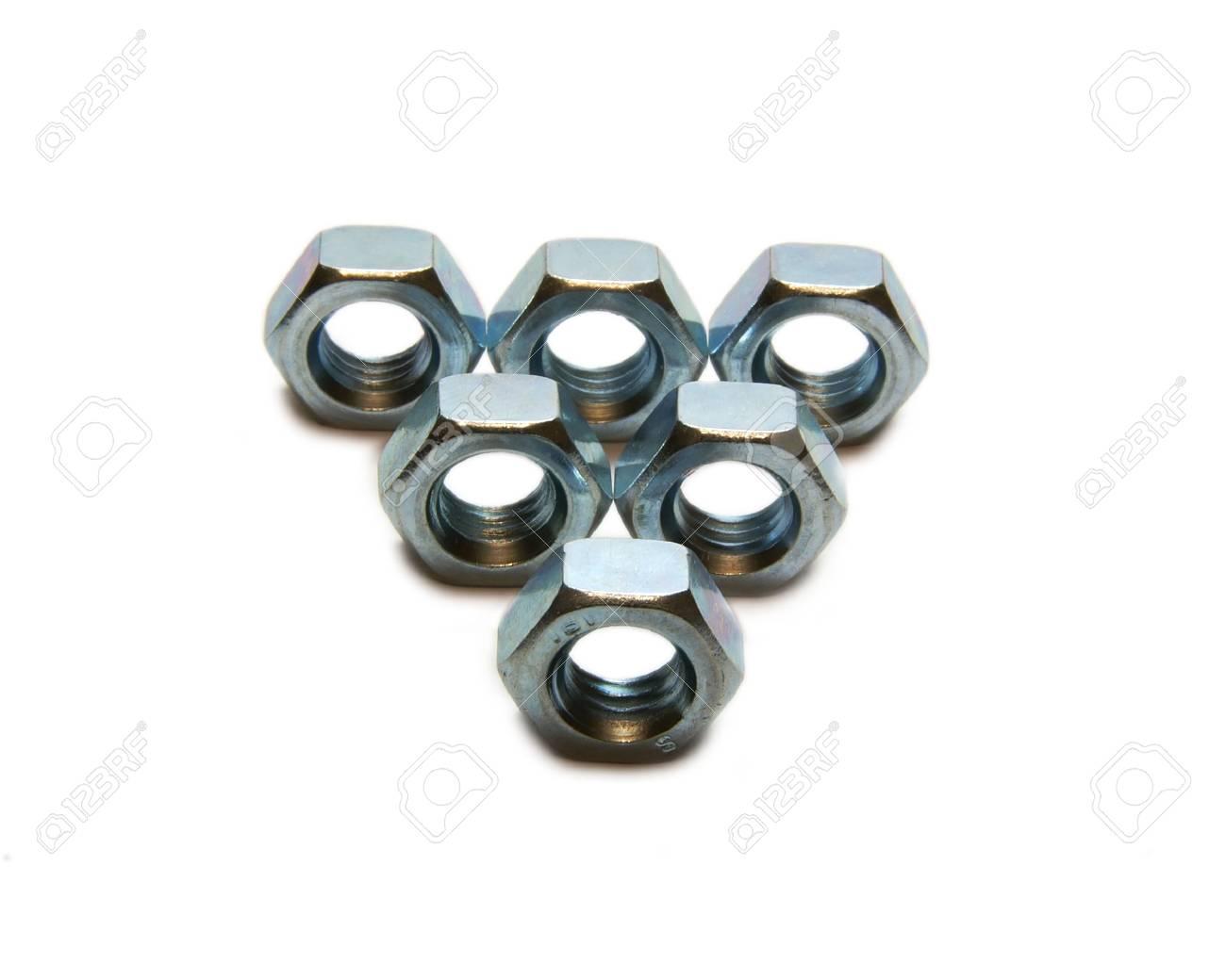 Six screw nuts, piramid, slose up, steel Stock Photo - 6759303