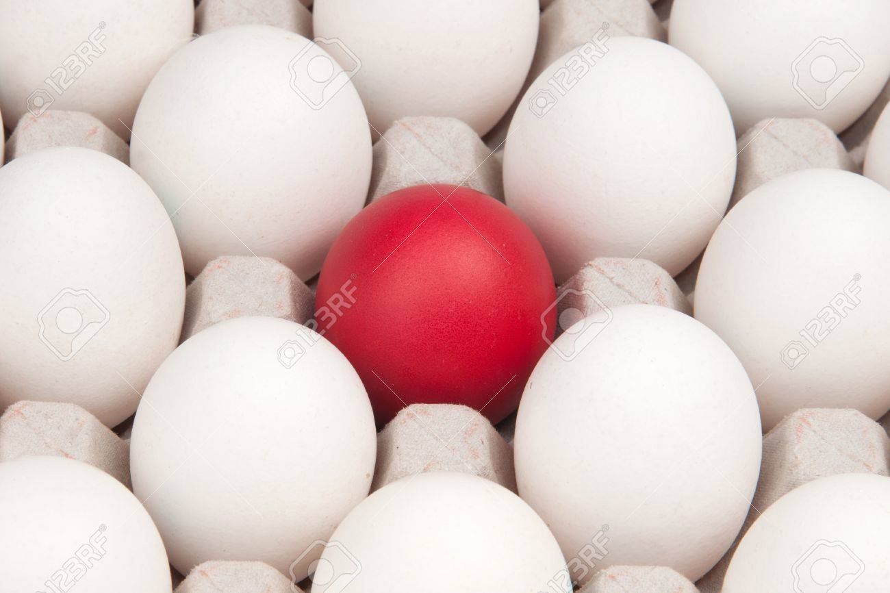 White Eggs With One Red Egg Stock Photo, Picture And Royalty Free ...