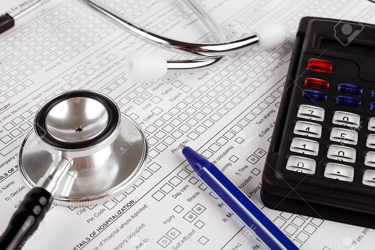 Healthcare costing. Medical phonendoscope, calculator, pen. - 148360838