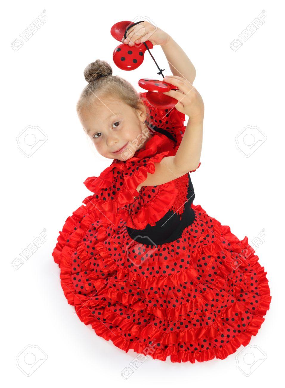 504eed1bb Foto de archivo - La niña en un vestido series españolas rojo