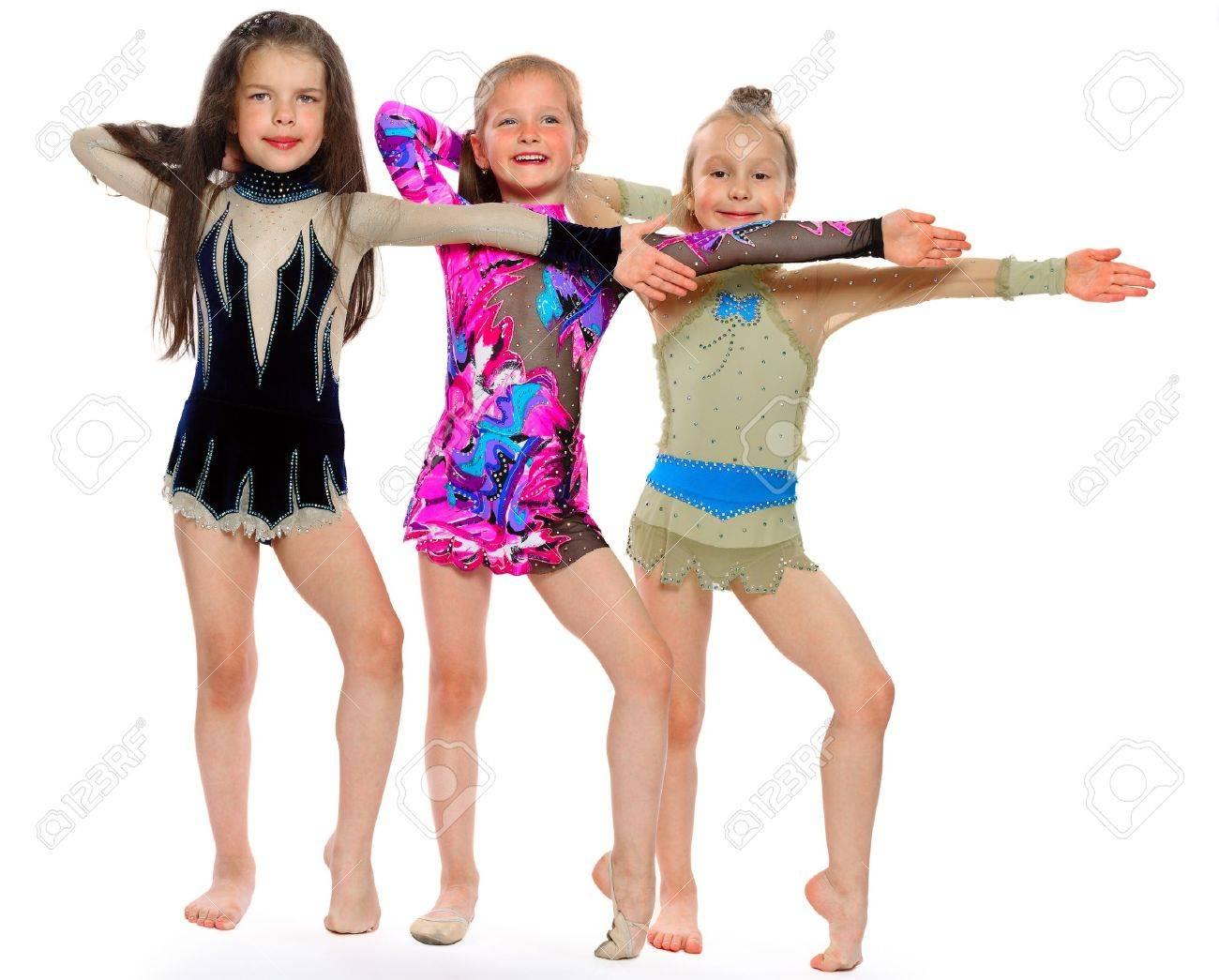 three gymnasts of the girl of 6 years carry out exercises isolated on white - 15327904