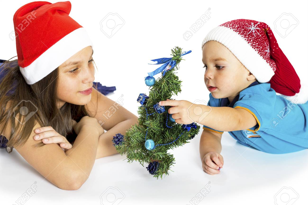 The little boy with the sister about a New Year tree Stock Photo - 16902264