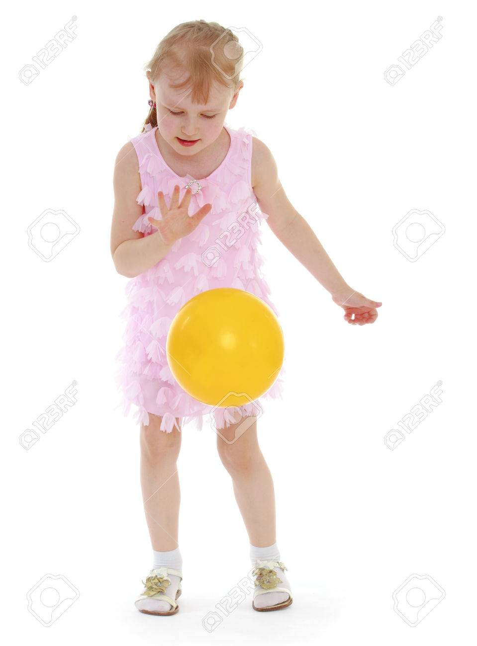 ilittle girl tosses the ballsolated on white background, sports life,happiness concept,happy childhood,carefree childhood,active lifestyle - 29730684