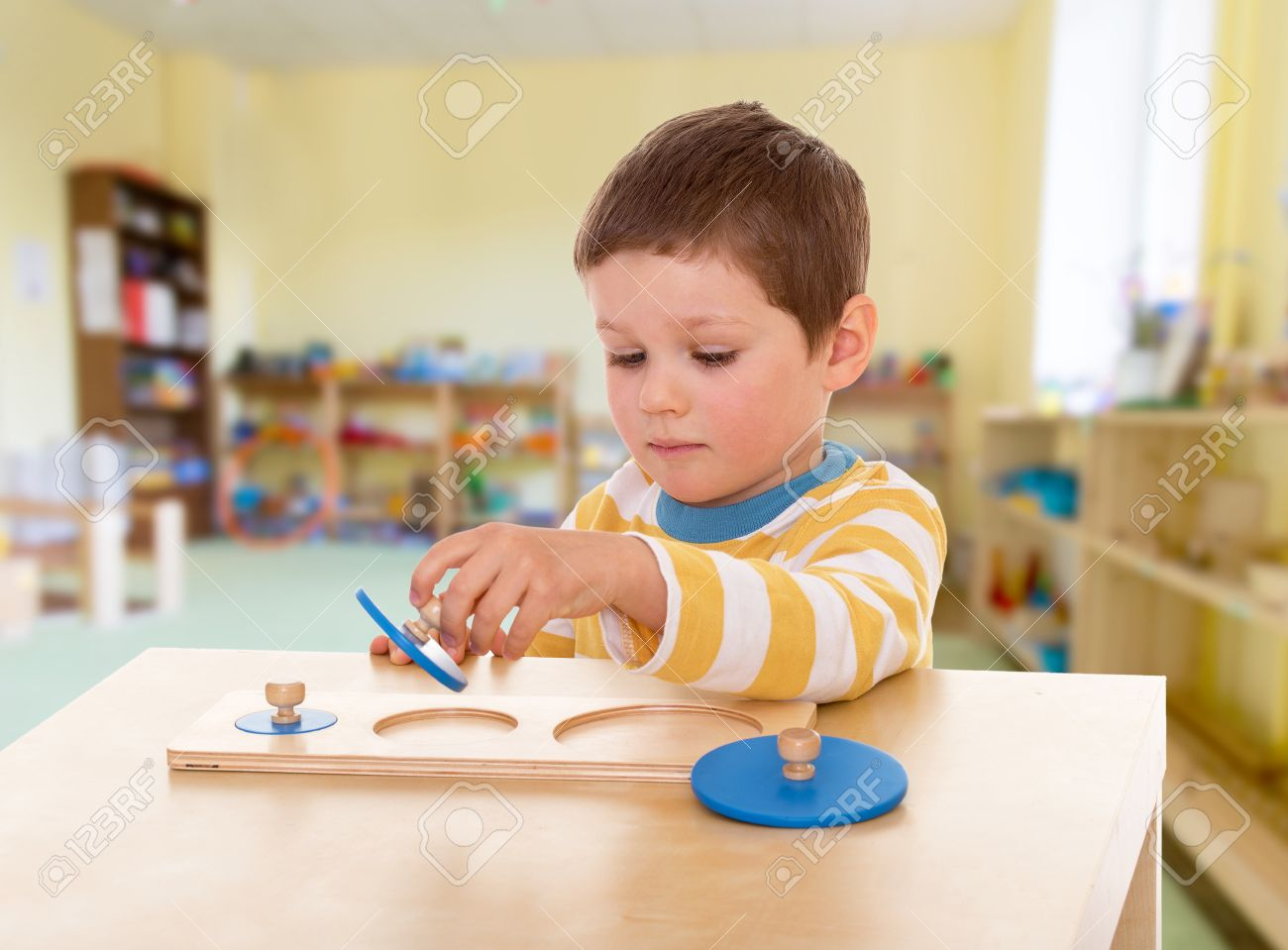 Boy engaged in the Montessori classroom kindergarten, the concept of childhood and joy, teens - 30362096