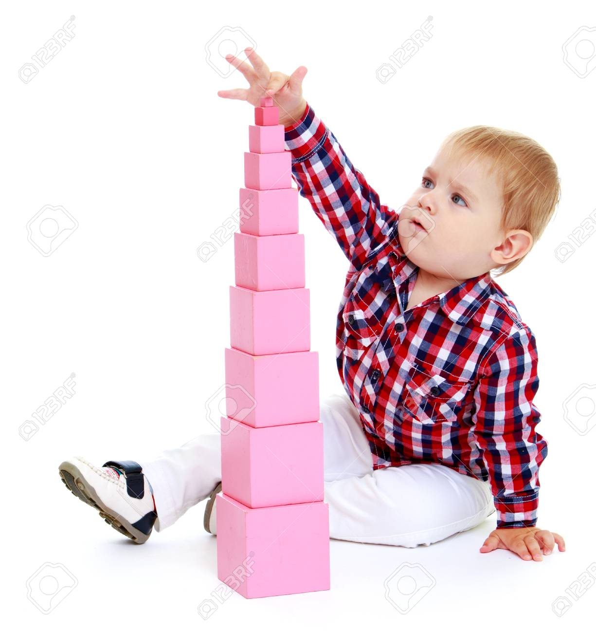 Little boy puts cubes.Early years learning a happy childhood concept.Isolated on white background. - 33594917