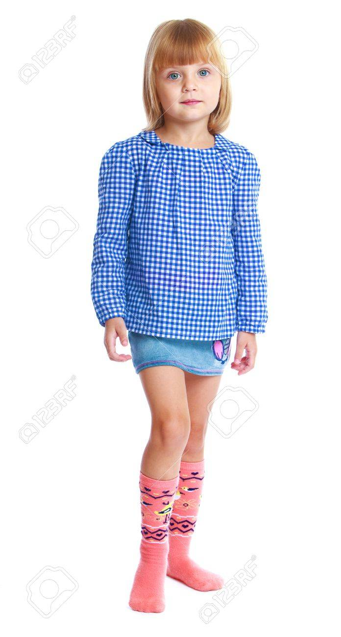 1dce3f76a88 charming little girl in a blue blouse and denim skirt isolated on white  background Stock Photo