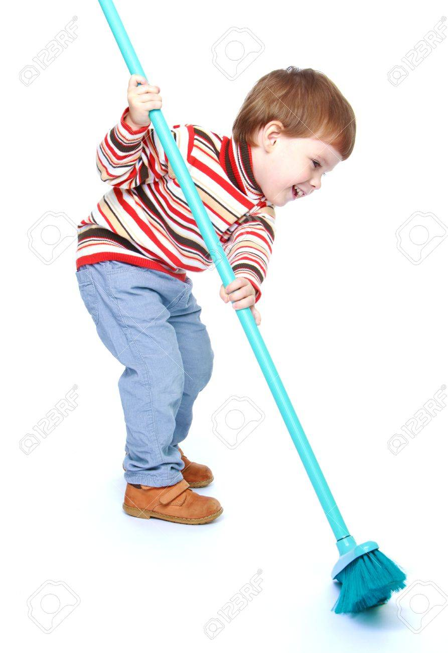 Little boy sweeping the floor with a brush.Isolated on white background portrait. - 34543595