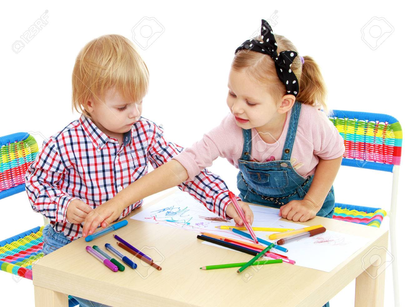 Boy and girl drawing with pencils sitting at the table.Isolated on white background. - 35752653