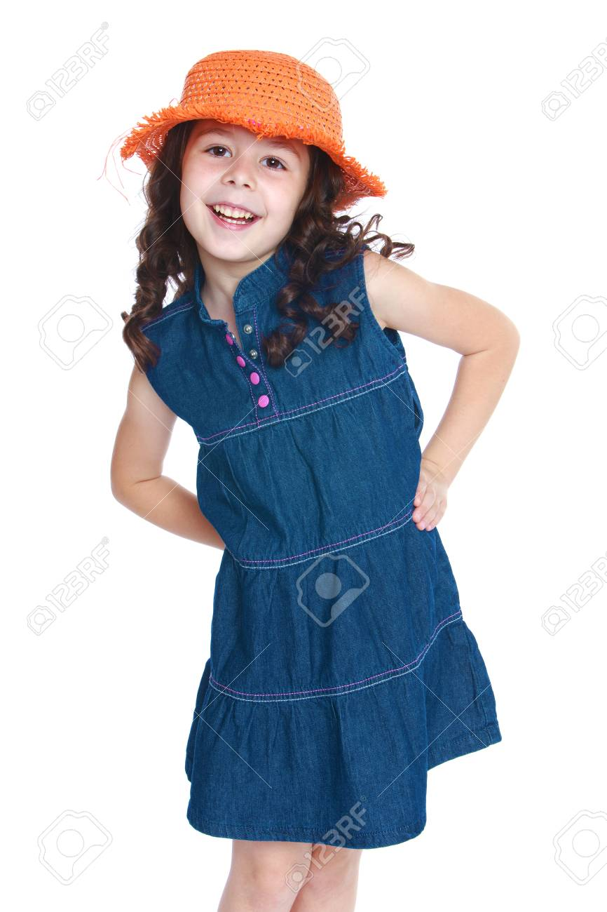b0999c1fc9f Beautiful little girl in a denim dress and orange hat.Isolated on white  background