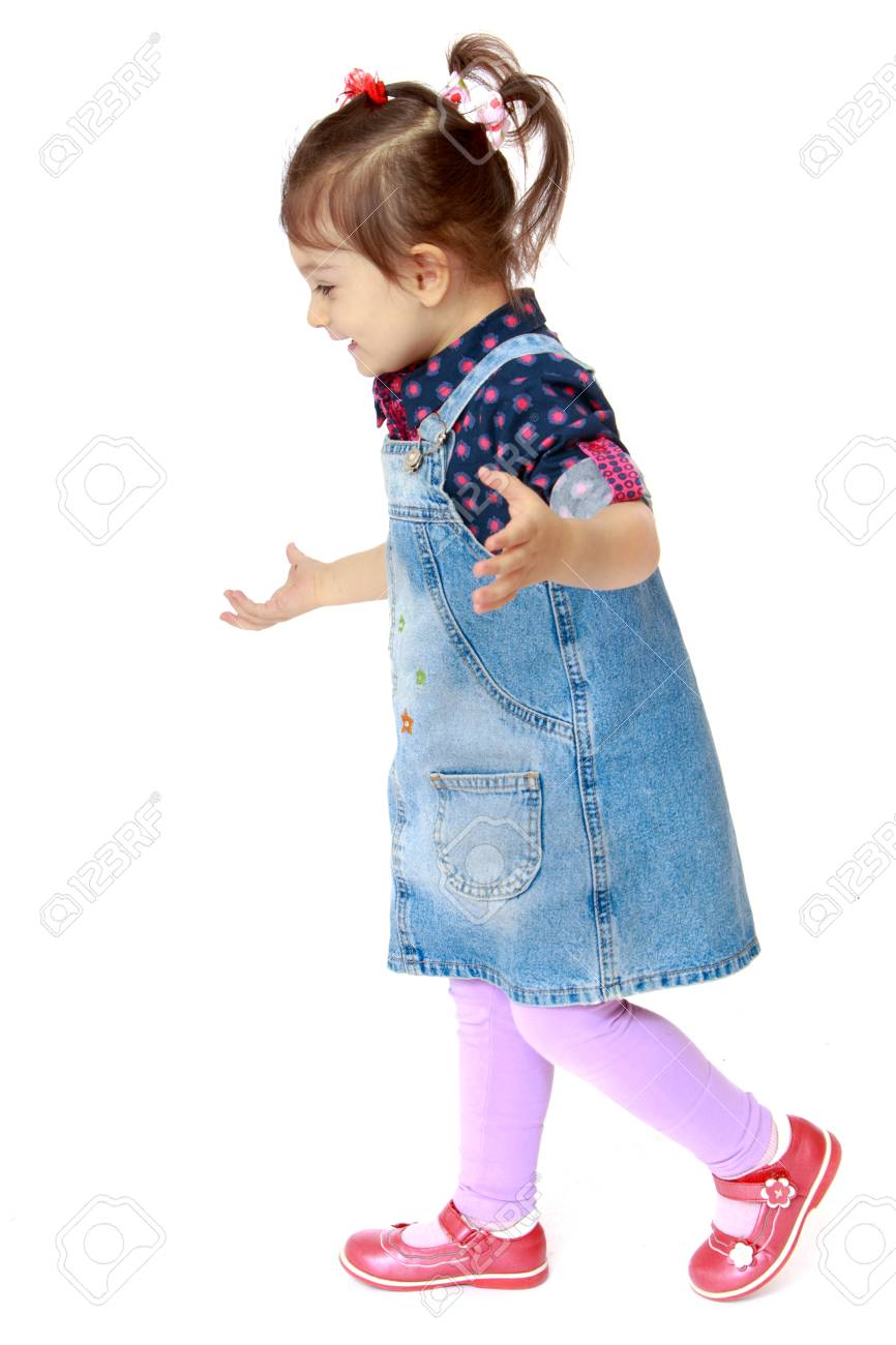 5b580ae67f1 Little girl in a denim dress on white background - isolated on white  background Stock Photo