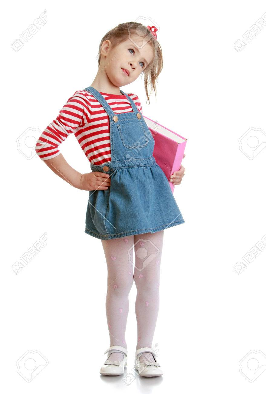 bfc45f2125d ... white background. Beautiful little girl in a short denim dress and a  book in his hand - isolated