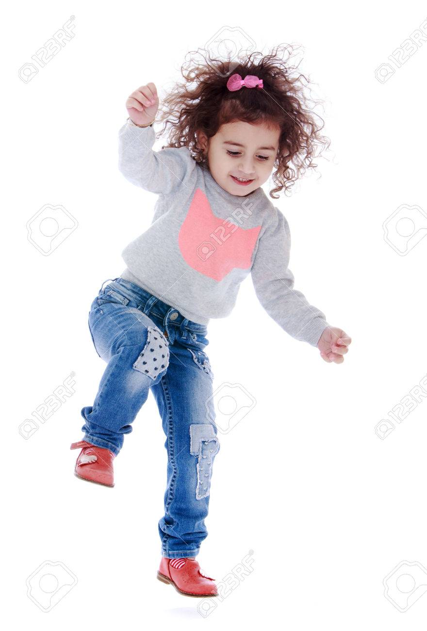 Fun little curly girl fun jumps - isolated on white background - 42462615