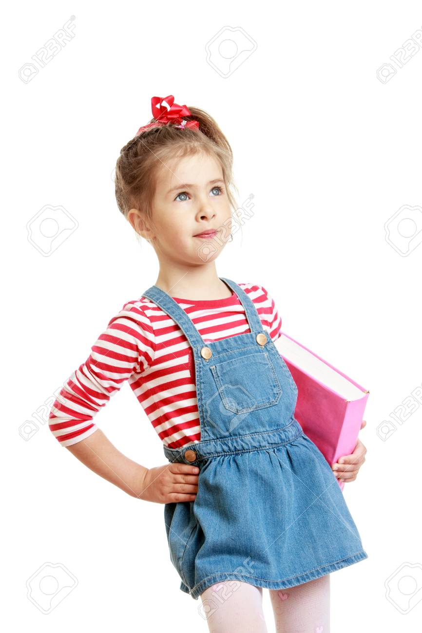 25dedc2b5b7 Adorable little girl in a short denim dress and pink striped t-shirt  holding under