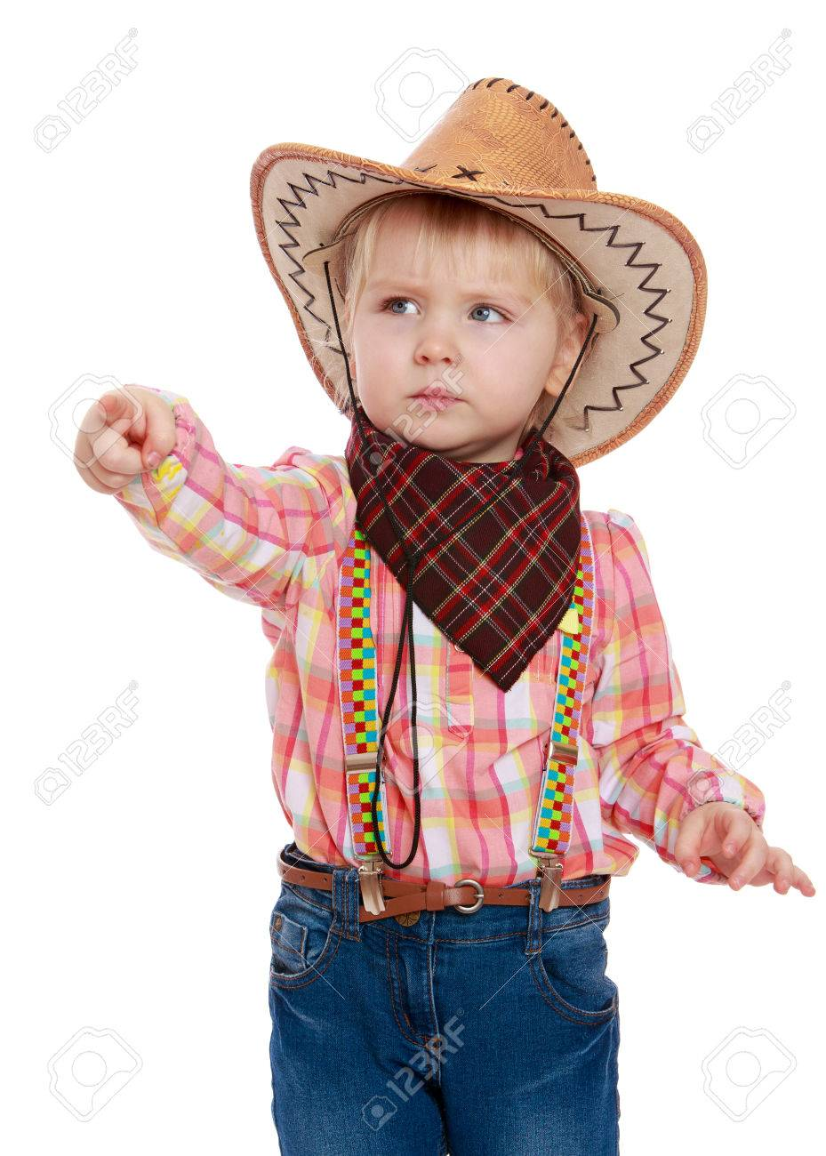 Stock Photo - The little blonde girl in a cowboy outfit. The girl shows a  finger to the side with a very serious face. A girl wearing a wide-brimmed  cowboy ... 2febd585e0b2