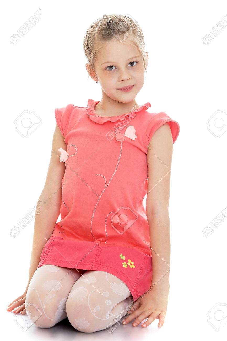 Cute Caucasian girl in a red blouse and a short pink skirt sits on your lap and look at the camera-Isolated on white background - 43428614