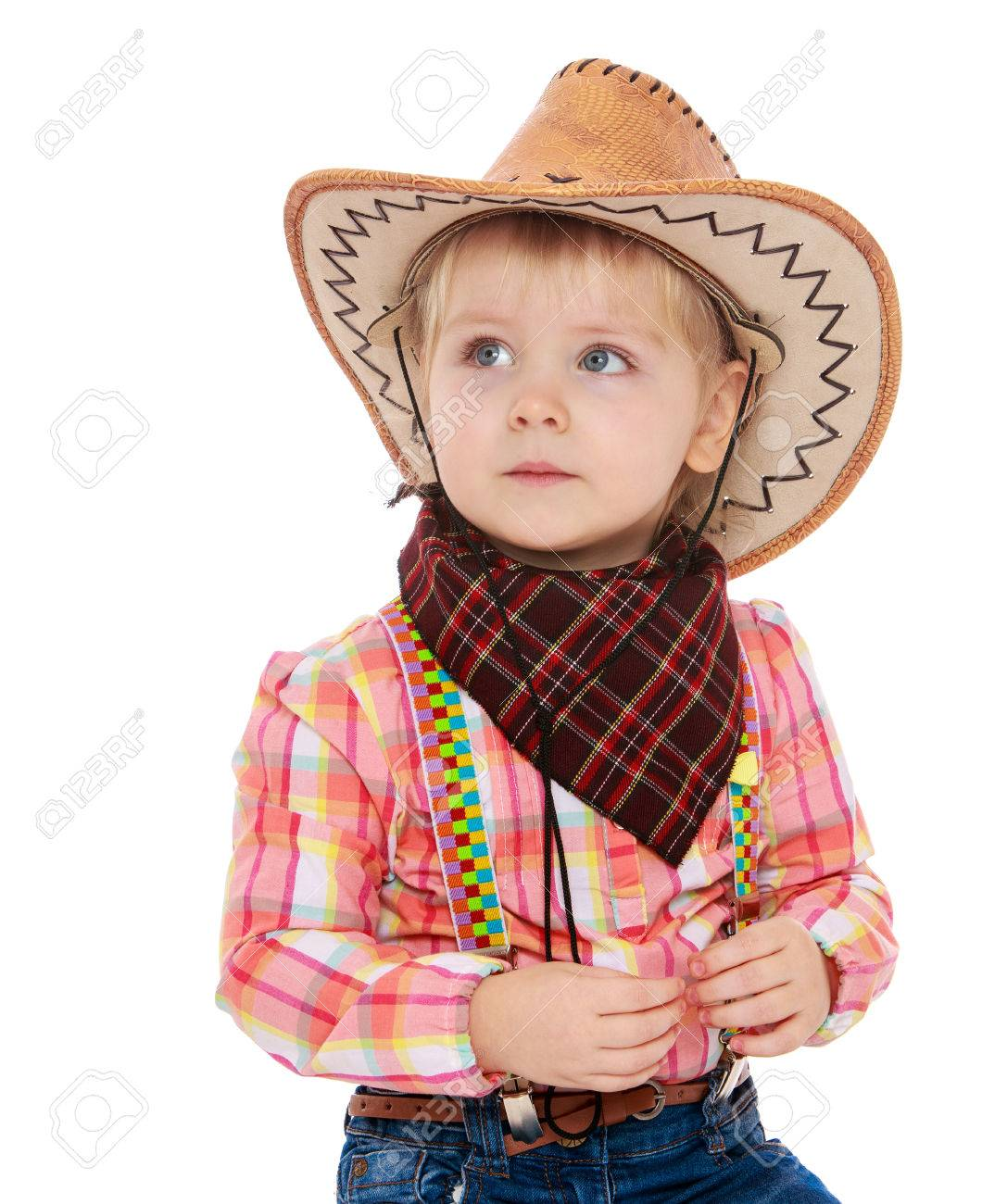 Beautiful little blonde girl in a cowboy outfit. On the head of the girl  wearing 98b3db682388