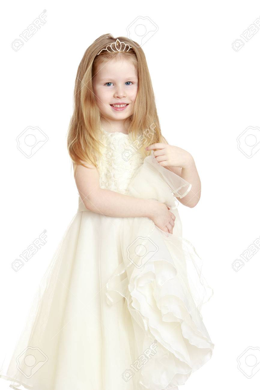 5f7ebe635dd8 Cute little girl with gray eyes and blond hair in a long white Princess  dress .