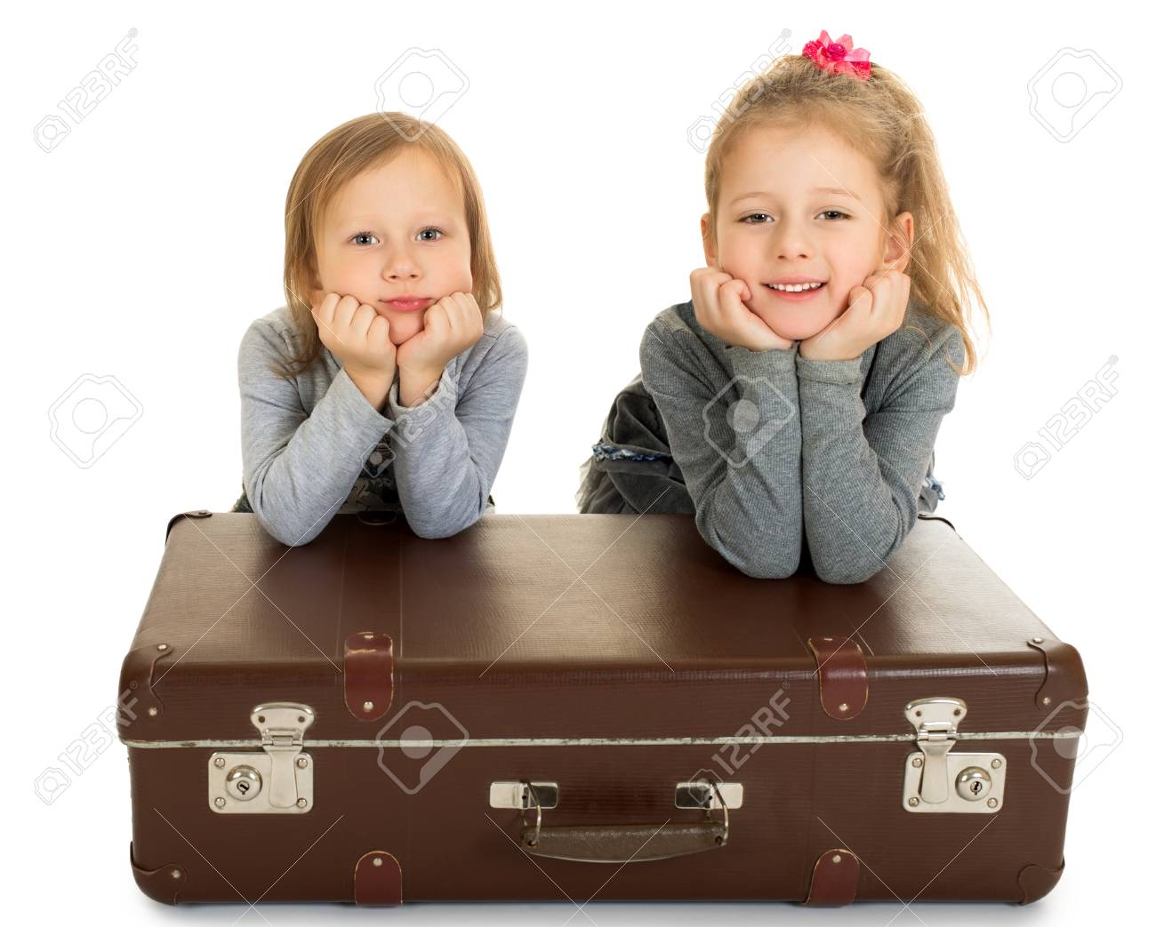 2 Beautiful Little Girls Sisters Leaning On A Big Old Suitcase Posing In Front Of The