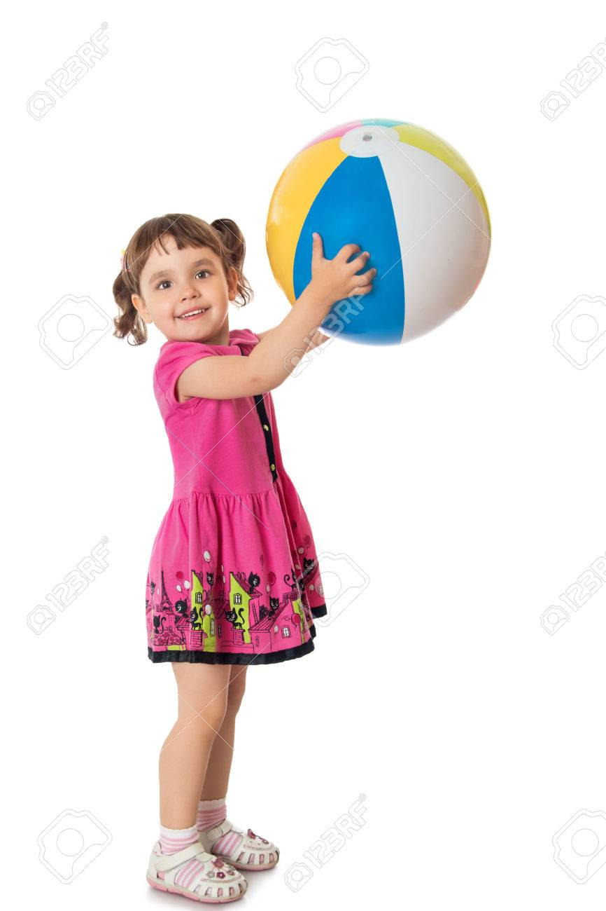 Happy little girl in a short pink dress throws a big striped ball - Isolated on white background - 49208704
