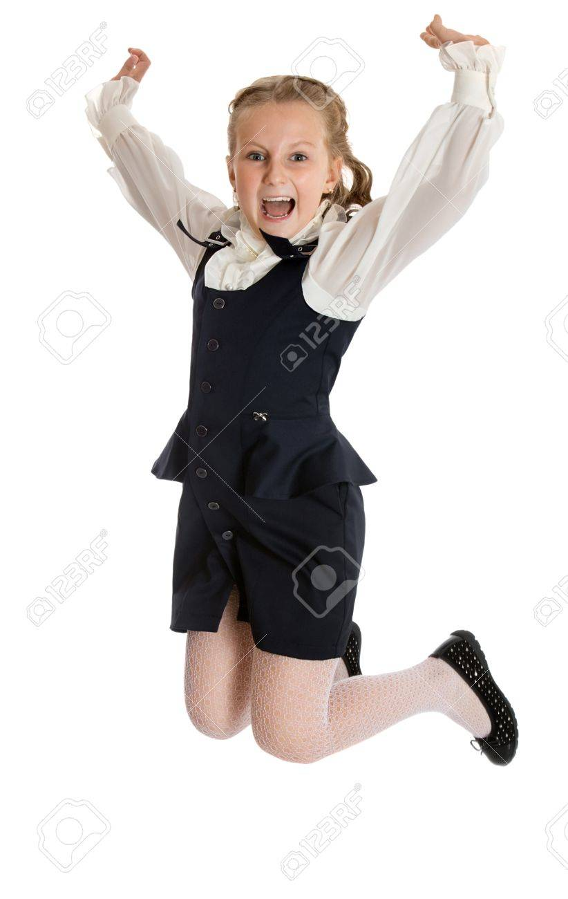 22dc5b33 Stock Photo - Stylish little girl in a black suit. Girl jumping raising his  hands up - Isolated on white background