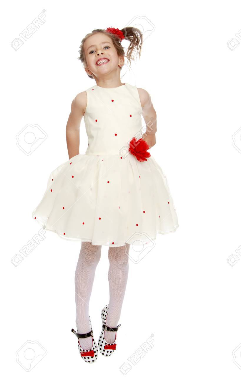 Cute Little Princess Dressed In A White Dress With A Red Flower