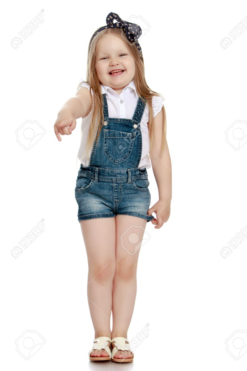 Funny Little Chubby Girl In Short Denim Jumpsuit Girl Laughing Pointing In The Direction