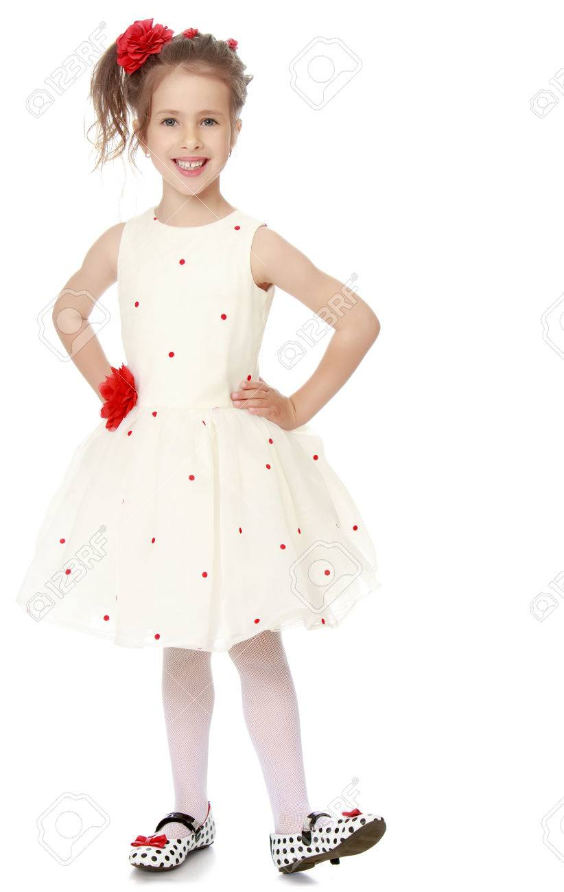 Nice Little Princess Dressed In A White Dress With A Red Flower