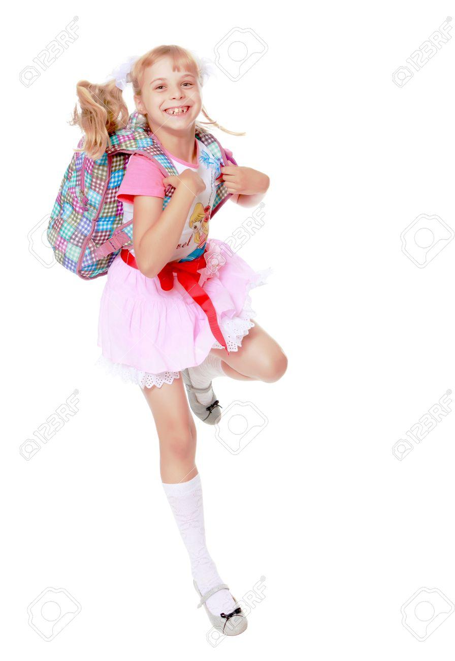 791bc144b78e4 Banque d images - Enthousiaste petite fille dans un rose se précipite jupe  courte à l école isolé sur fond blanc