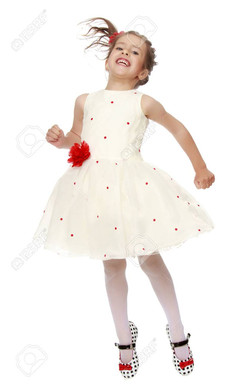Joyful Little Princess Dressed In A White Dress With A Red Flower
