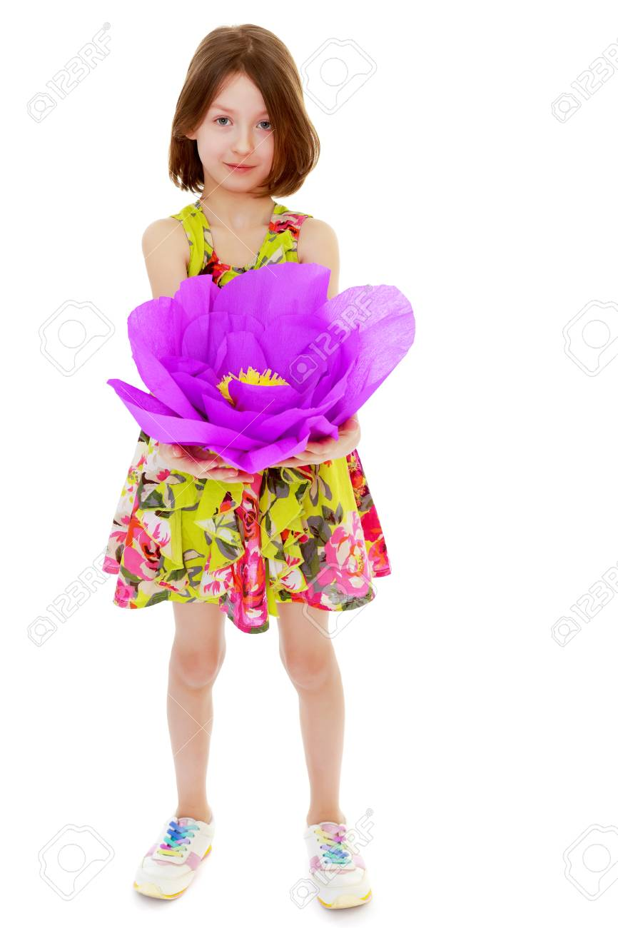 c76d99b787273 Adorable little girl in summer dress holding a large purple flower made of  paper.Isolated