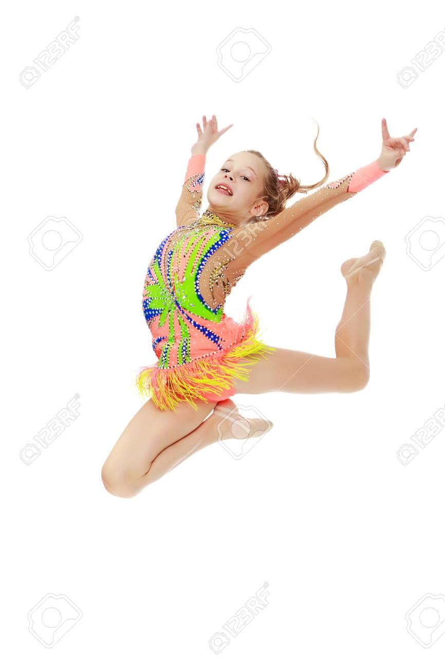 Girl gymnast performs a jump. - 77894674