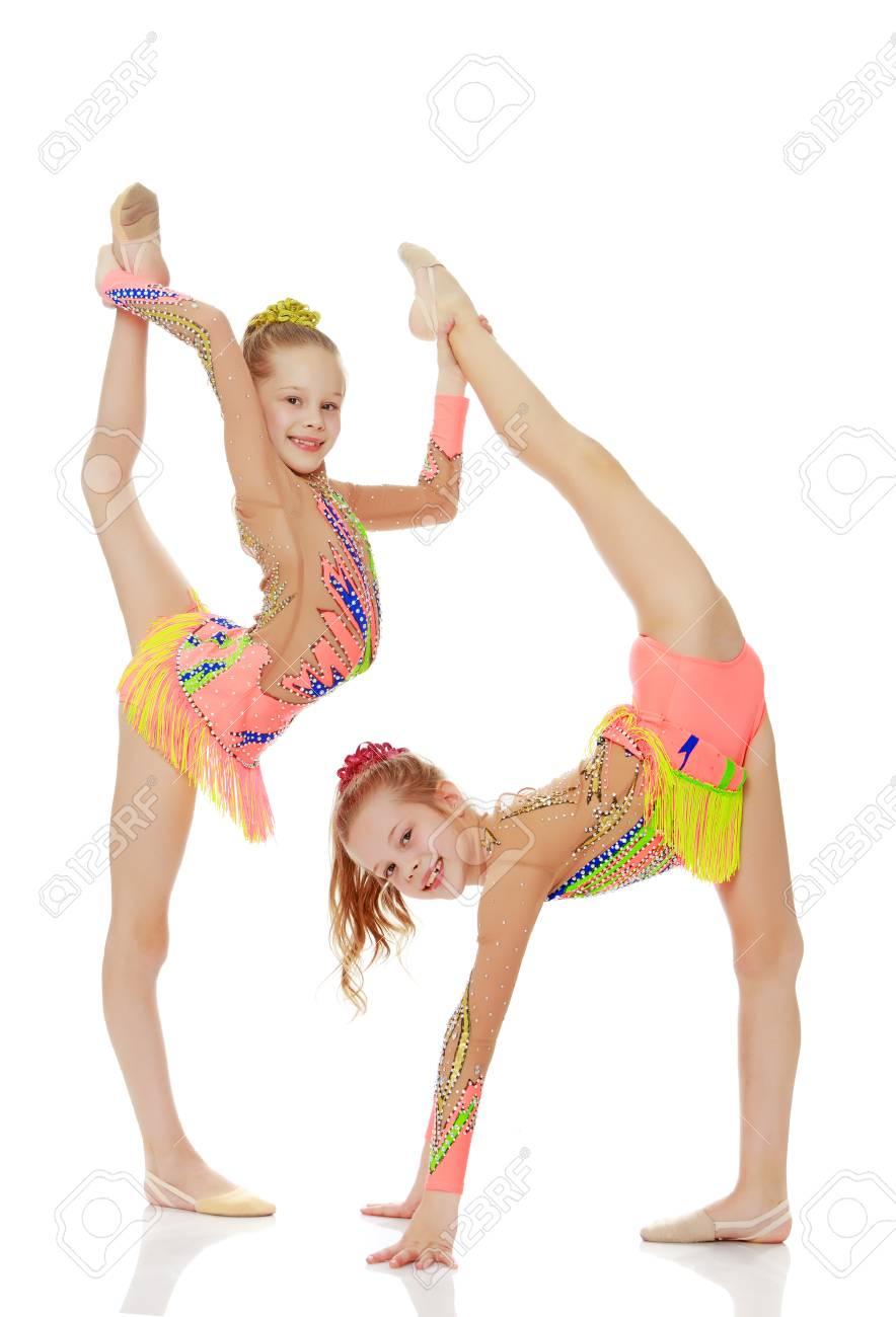Two girls gymnast sitting on splits. - 78028651