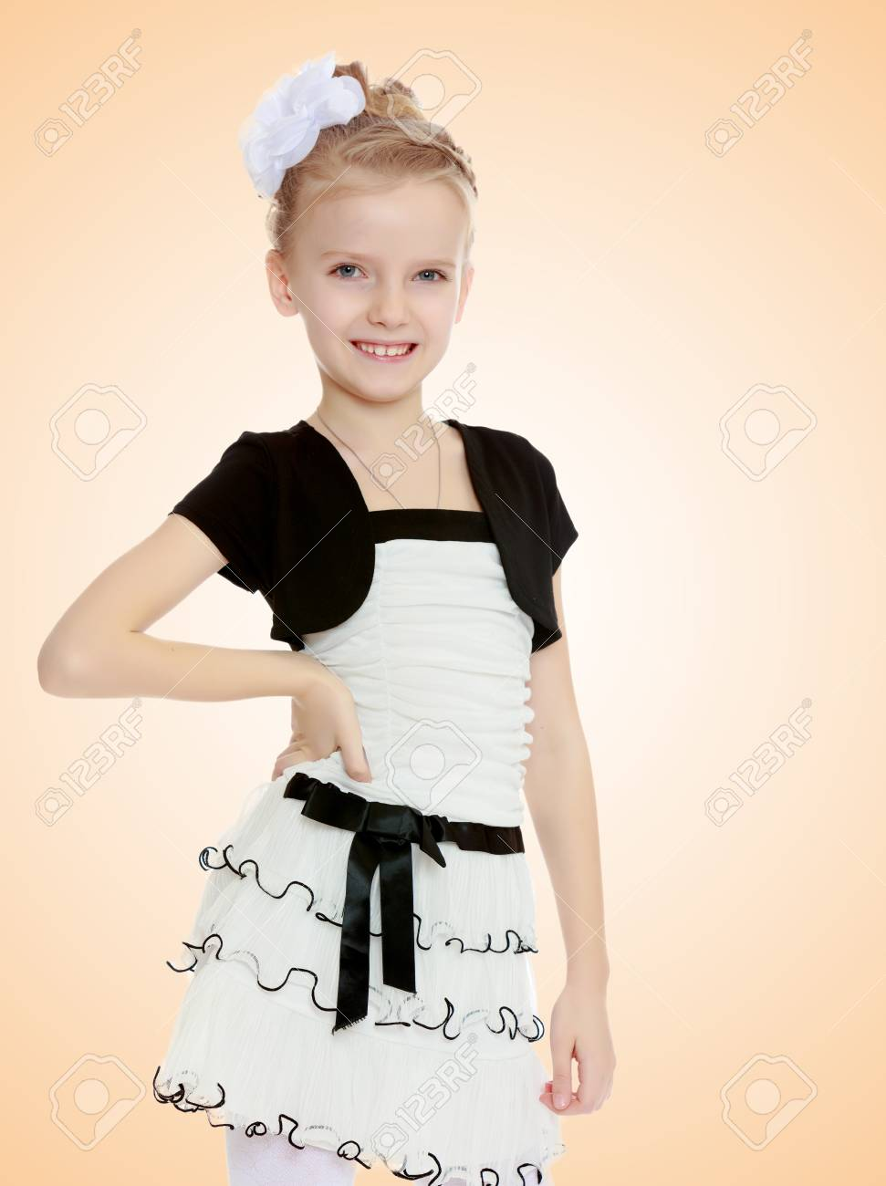 ee966b11f50e Beautiful Little Girl In A White Short Dress With A Black Belt ...