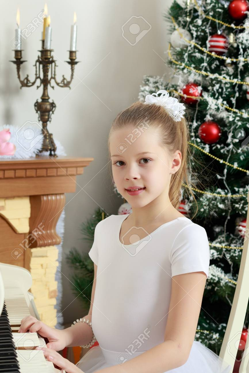 The Girl Presses The Keys Of The Piano. Stock Photo, Picture And ...