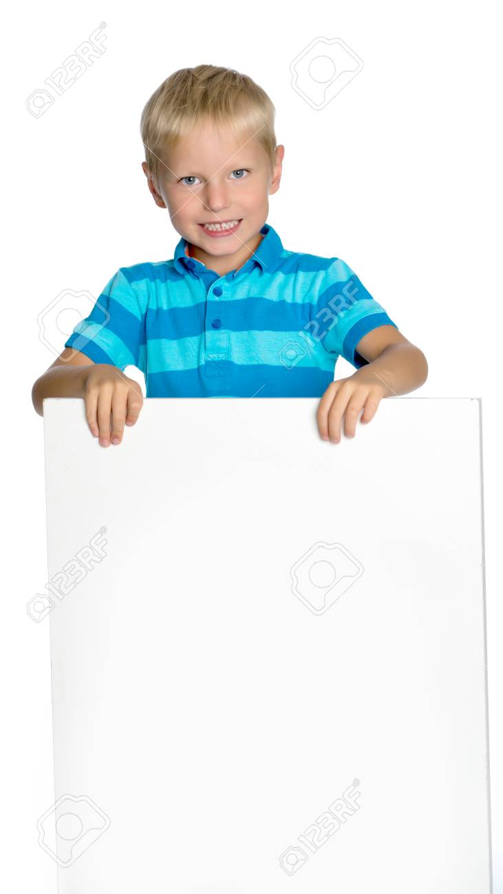 A little boy is looking from behind an empty banner. - 92091342