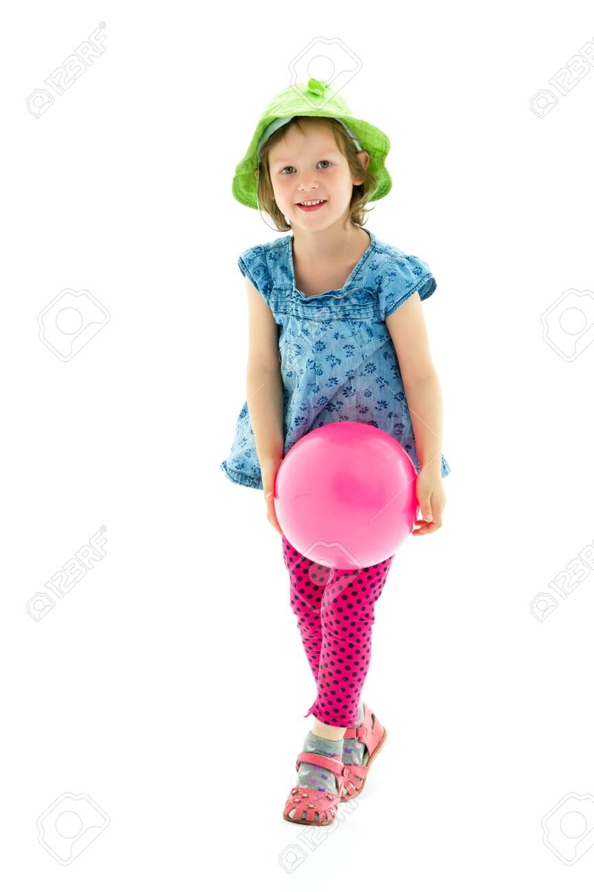 Little girl is playing with a ball - 131822940