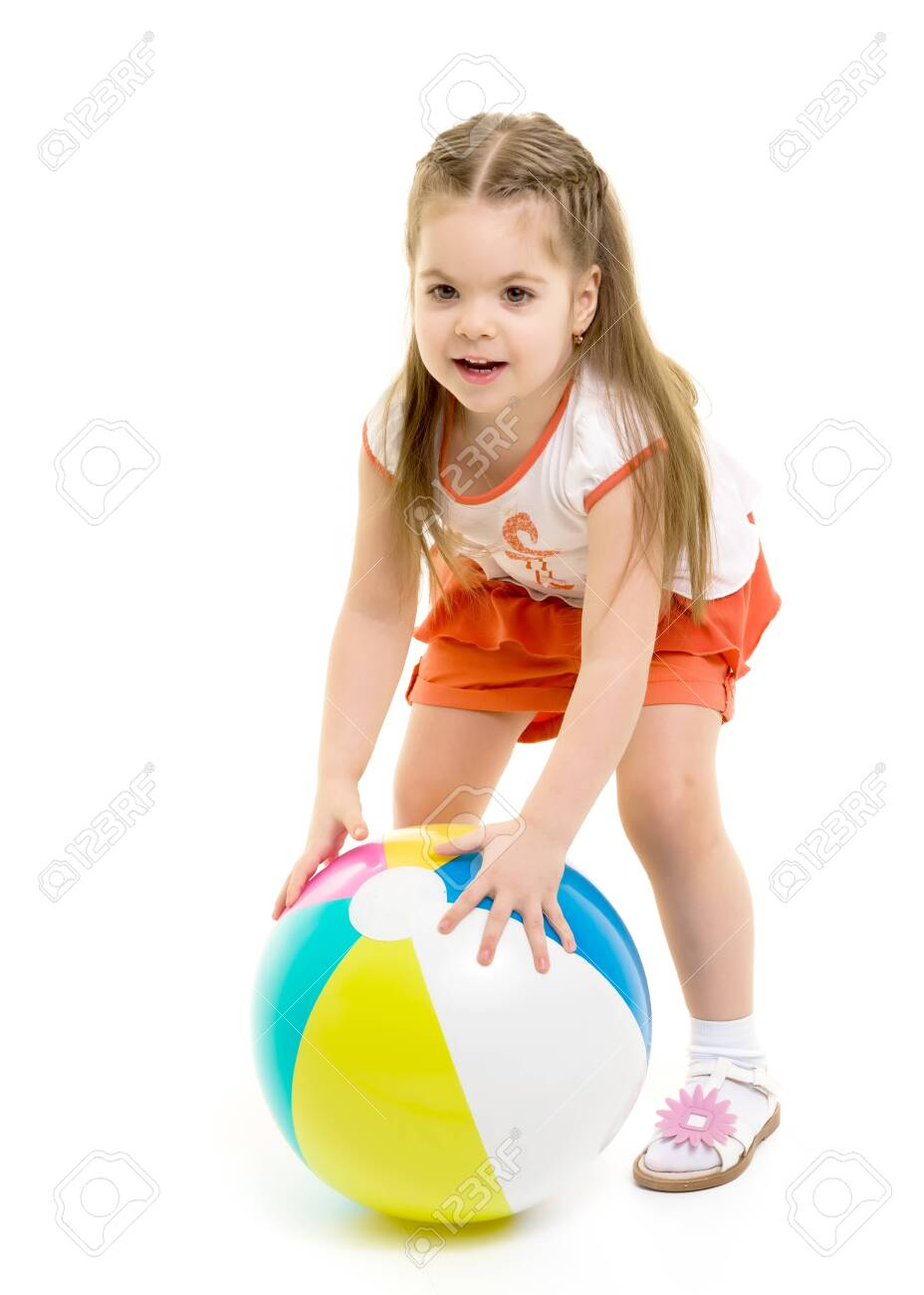 Little girl is playing with a ball - 130618583