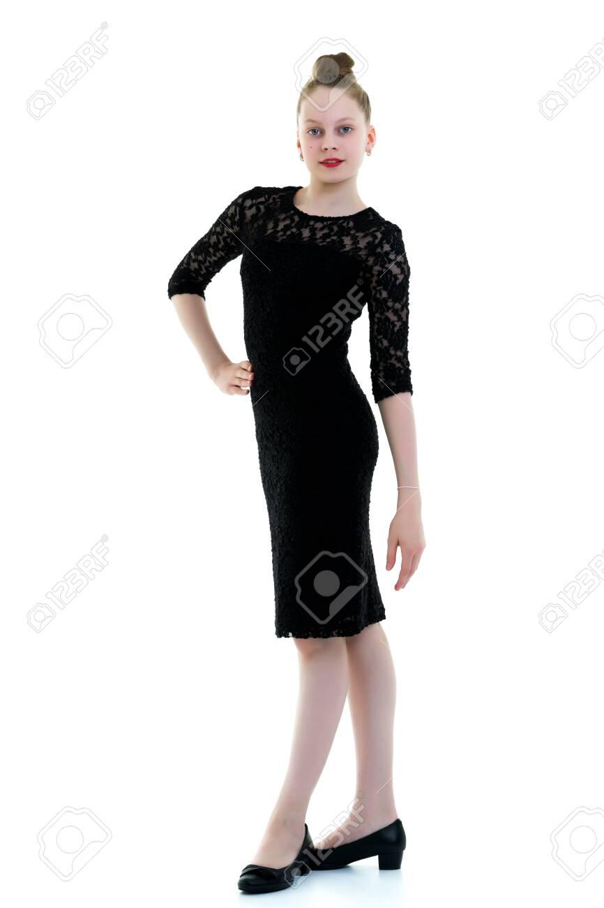 Little girl in an elegant dress. - 149172392