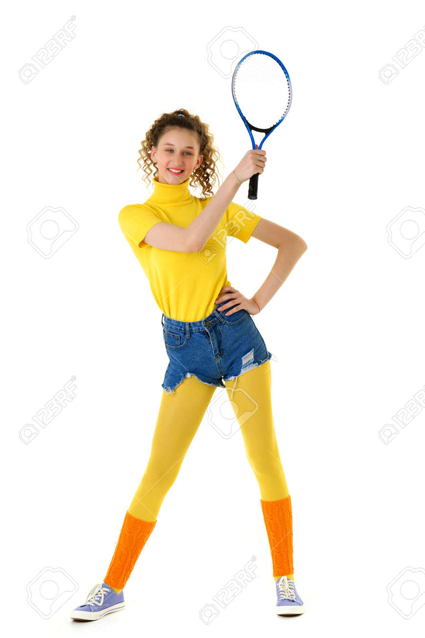 Happy sports girl tennis player posing with racket - 173179381