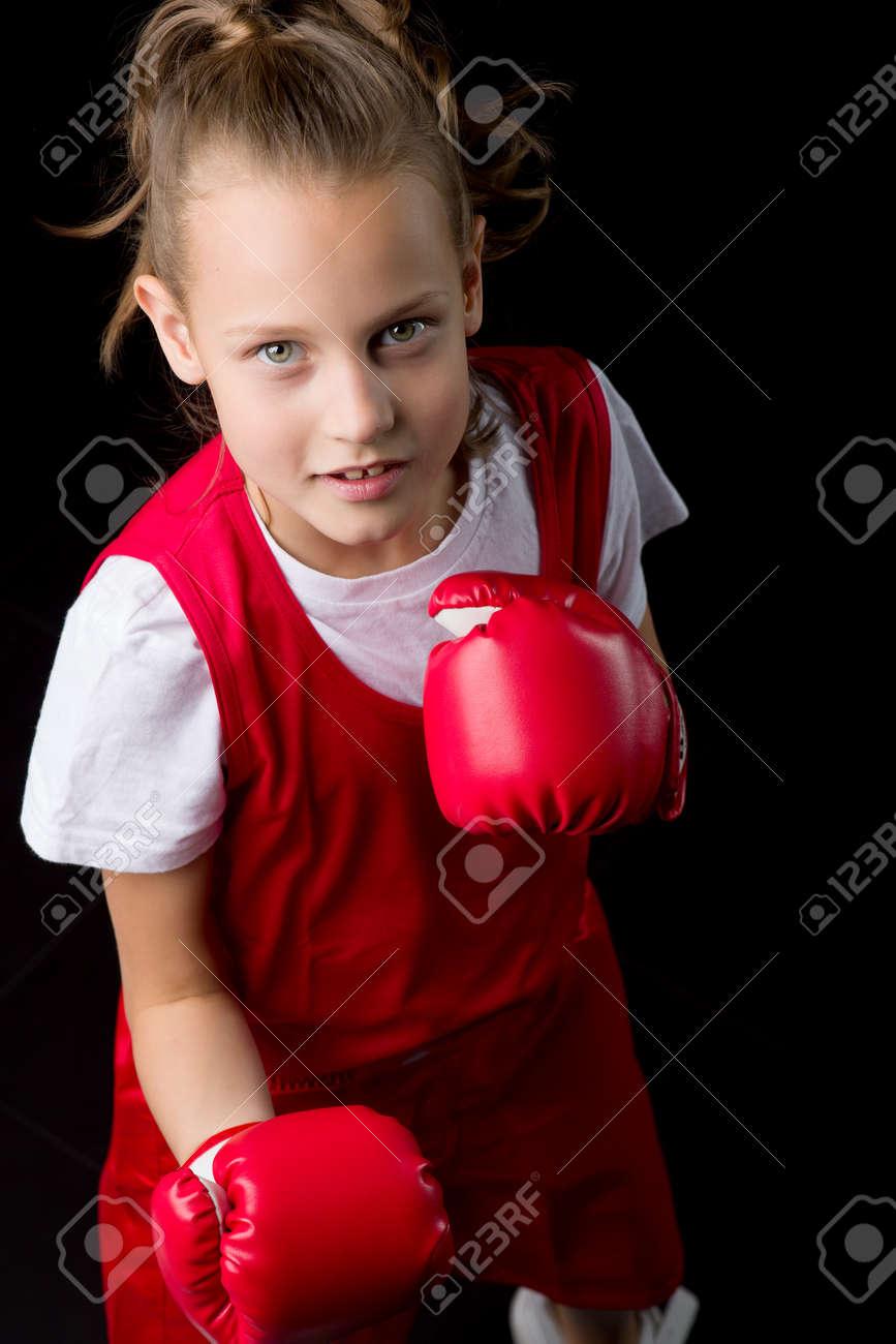 Sporty teenage girl doing boxing exercises - 172905245