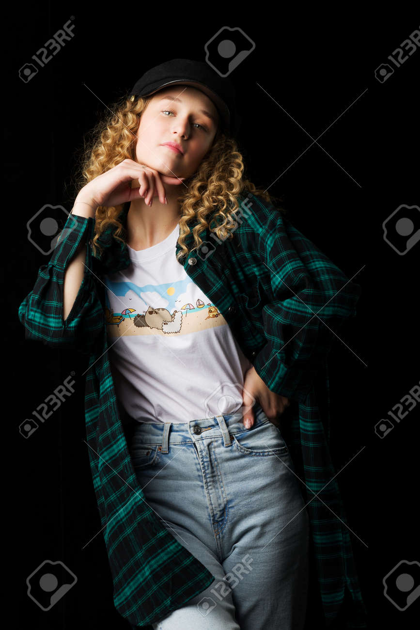 Charming girl posing keeping hand under her chin - 172916189
