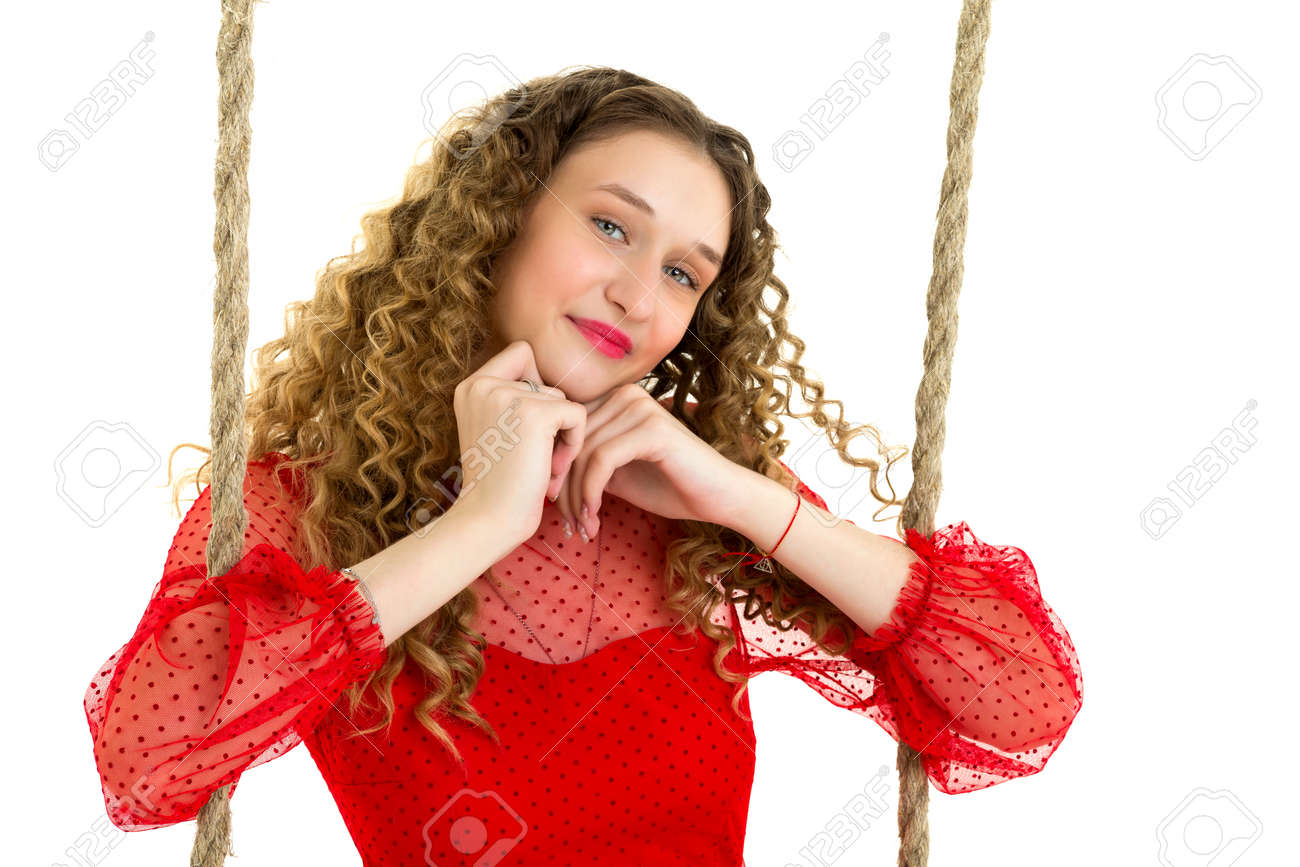 Portrait of pretty blonde young woman on swing - 172917723