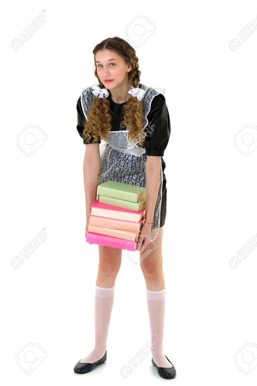 Tired pretty girl carrying pile of heavy books - 172926864