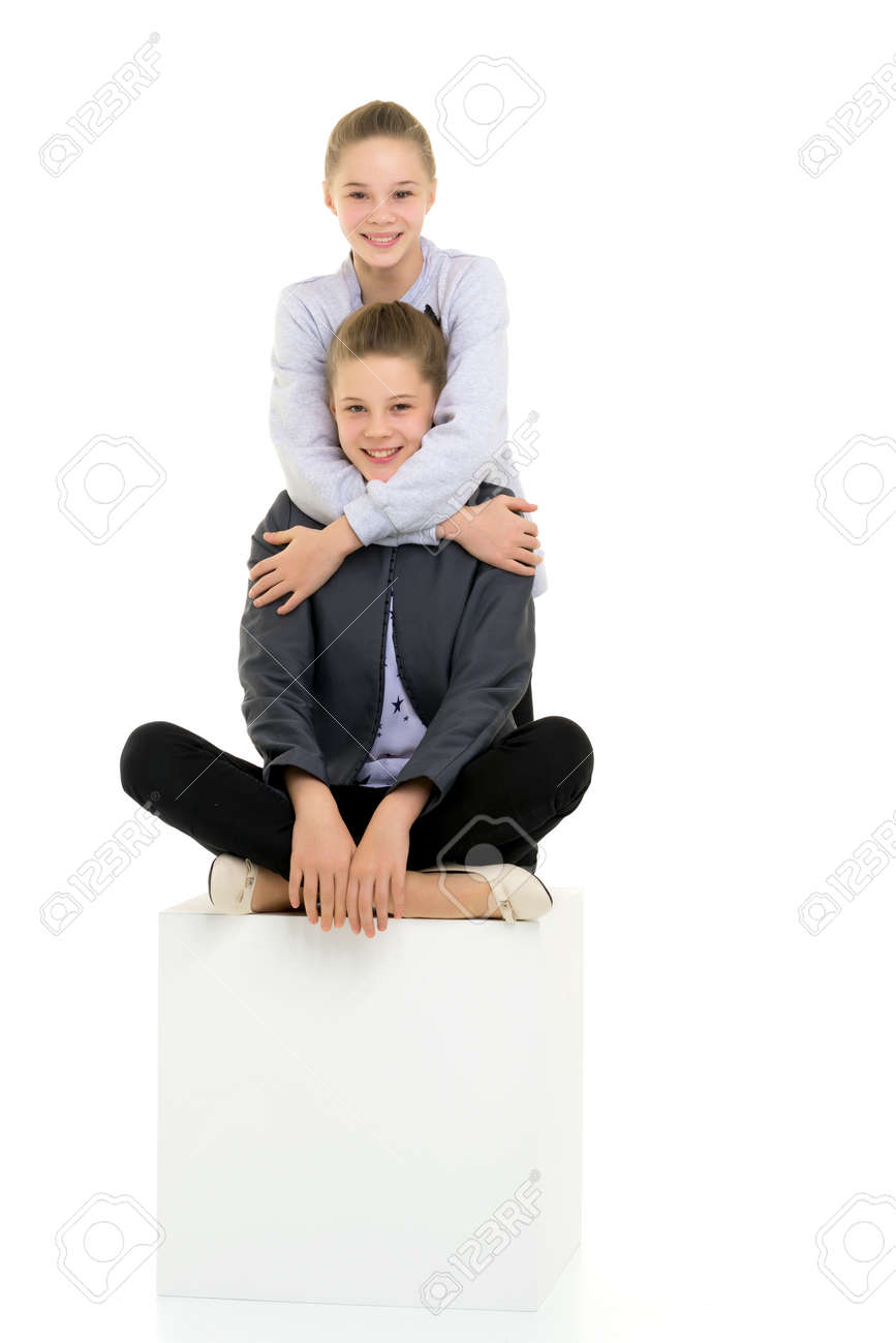 Teenage Girls in Stylish Outfit Posing Against White Background - 173027798