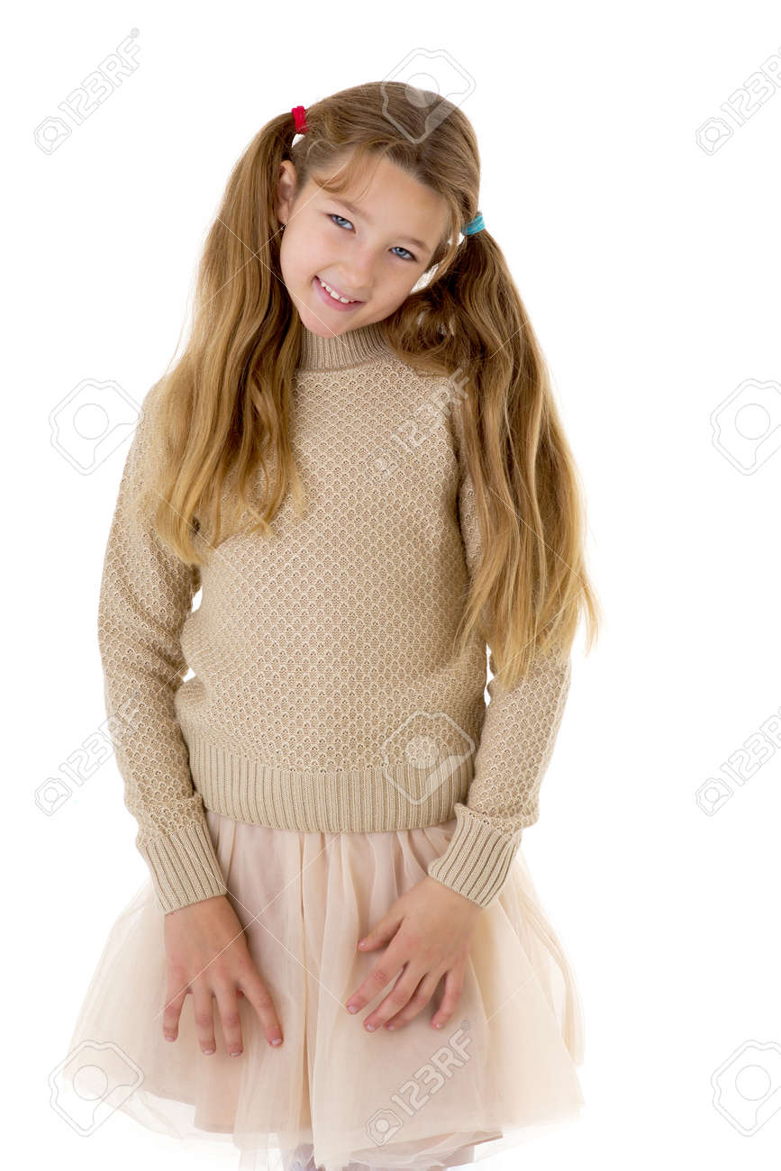 Thoughtful preteen girl. Posing against white background. - 173105463