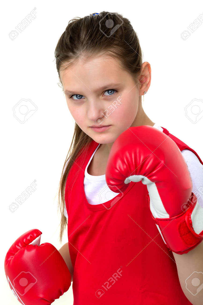 Smiling girl training in boxing gloves - 173199995