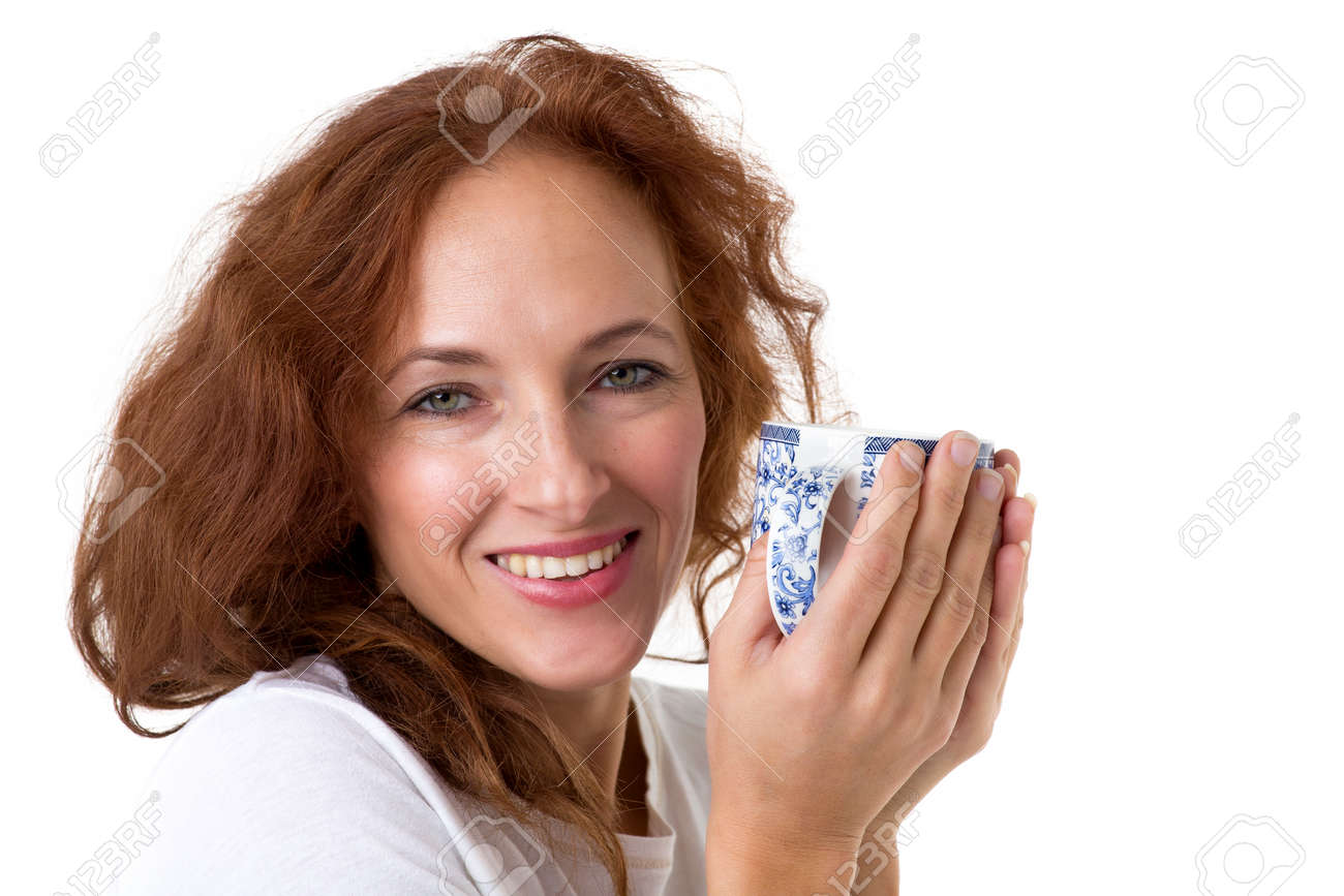 Smiling woman holding porcelain mug - 173233044