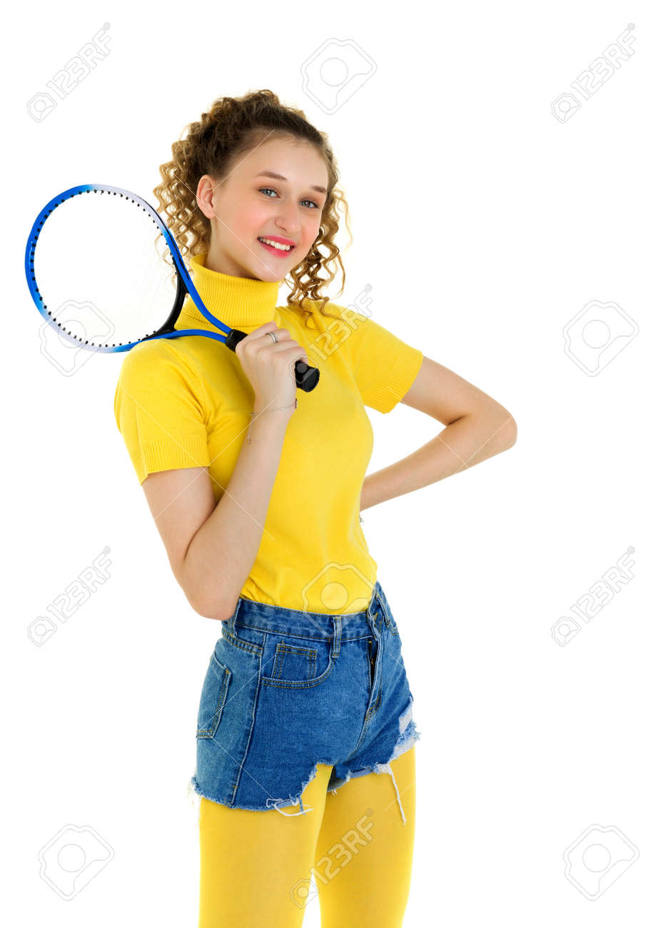 Portrait of happy girl posing with tennis racket - 173414771