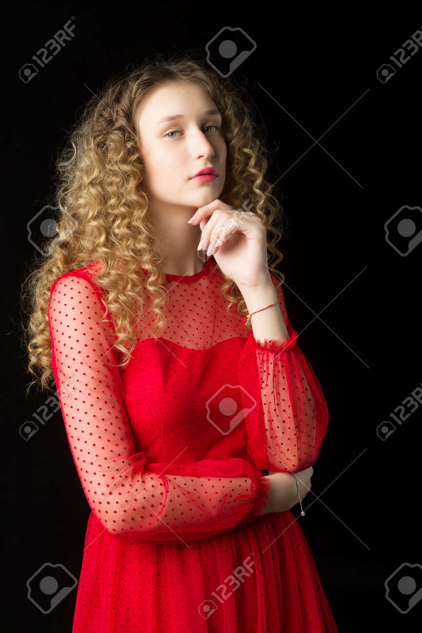 Portrait of thoughtful girl in short red dress - 173243947